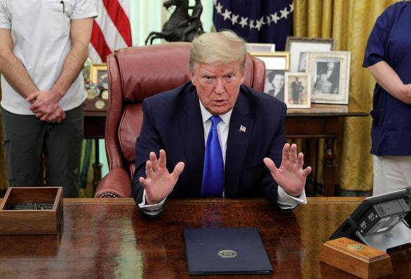 Ông Trump nói COVID-19 còn tệ hơn vụ khủng bố 11-9 - Ảnh 1.