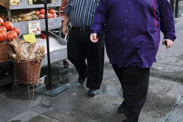 COVID-19 ảnh hưởng đến cân nặng như thế nào? - Ảnh 1.