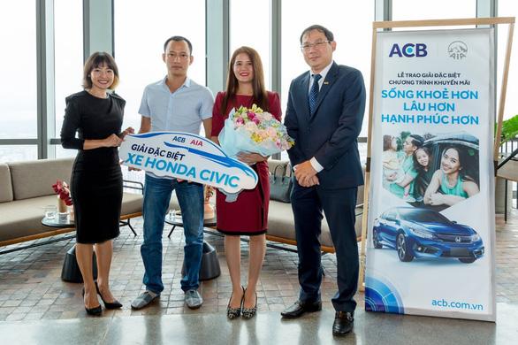AIA Việt Nam và ACB trao thưởng Honda Civic cho khách hàng tại Hội An - Ảnh 3.