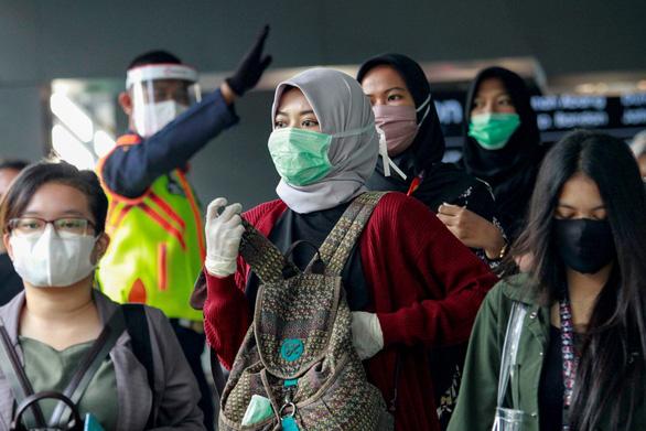 Vừa nới giãn cách, Indonesia tăng 1.241 ca trong 24 giờ - Ảnh 1.