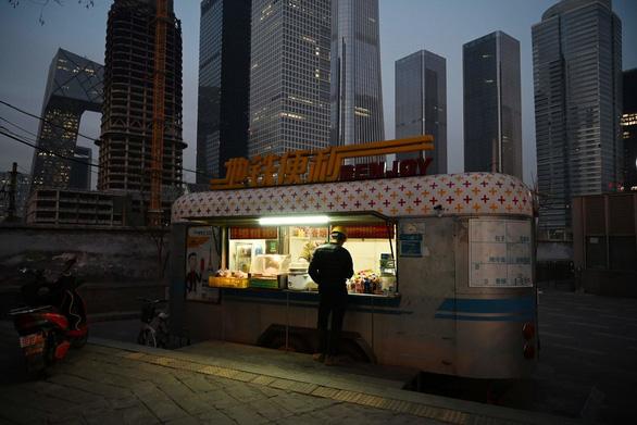 Thủ tướng Trung Quốc gây tranh cãi vì kêu dân thất nghiệp bán hàng rong - Ảnh 3.