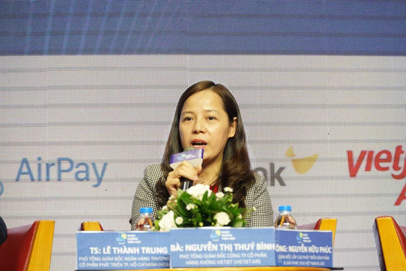 Ngân hàng Nhà nước và doanh nghiệp chung tay thúc đẩy thanh toán không dùng tiền mặt - Ảnh 2.