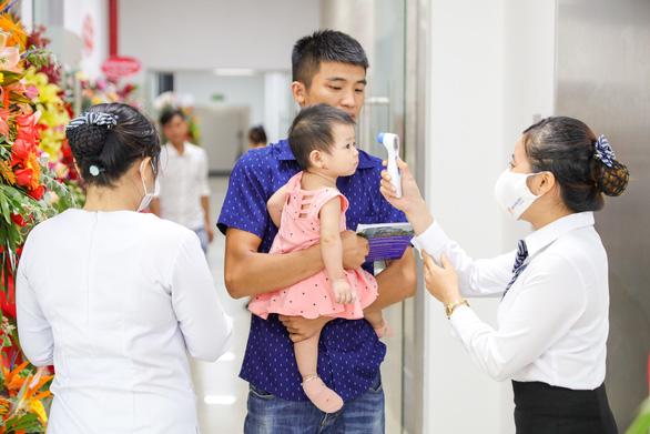 Khai trương Trung tâm tiêm chủng VNVC Dĩ An - Ảnh 1.