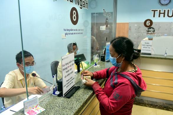 TP.HCM đề nghị tháo điểm nghẽn thanh toán không tiền mặt - Ảnh 1.