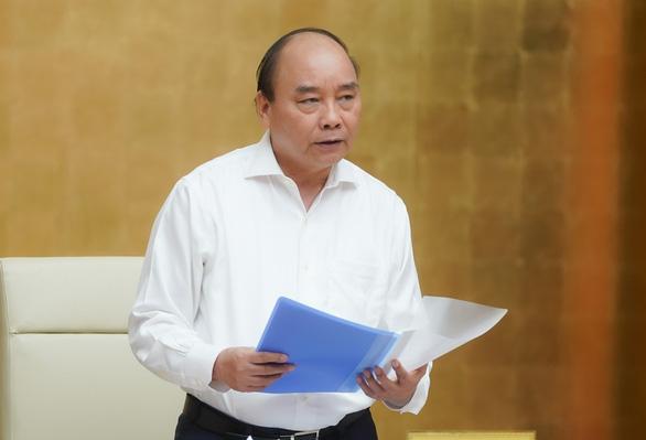 Thủ tướng họp về phòng chống COVID-19: Chưa cho du khách vào Việt Nam - Ảnh 1.