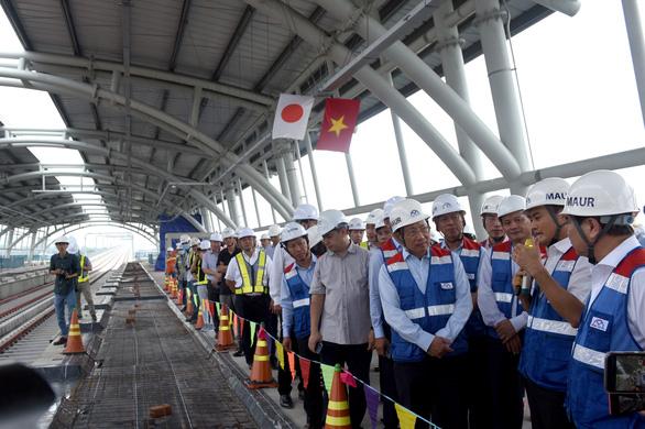 Phó thủ tướng Phạm Bình Minh thị sát tuyến metro Bến Thành - Suối Tiên - Ảnh 1.