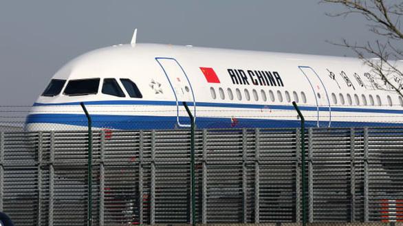 Mỹ cấm chuyến bay thương mại Trung Quốc từ 16-6 - Ảnh 1.