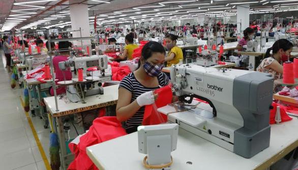 Lao động toàn cầu khó phục hồi 6 tháng cuối năm vì COVID-19 - Ảnh 1.