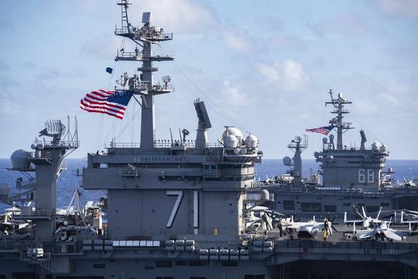Mỹ, Trung nắn gân nhau bằng tập trận ầm ĩ trên biển - Ảnh 1.