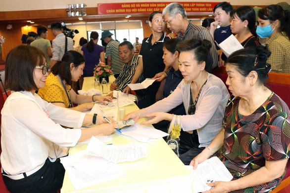 Bộ trưởng Đào Ngọc Dung: Đừng để tiền hỗ trợ dù rất bé lọt vào nhà quan - Ảnh 2.