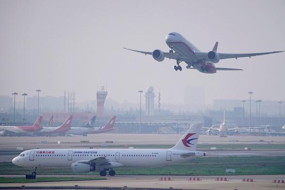 Đạt mục đích sau đòn ép, Mỹ tính chuyện rút lệnh cấm chuyến bay từ Trung Quốc? - Ảnh 1.