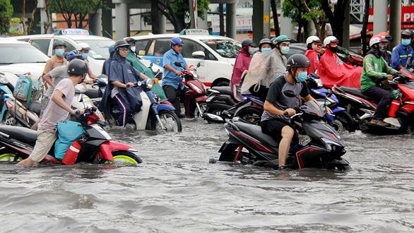 Tháng 4-2021, rốn ngập ở đường Nguyễn Hữu Cảnh hết ngập? - Ảnh 1.