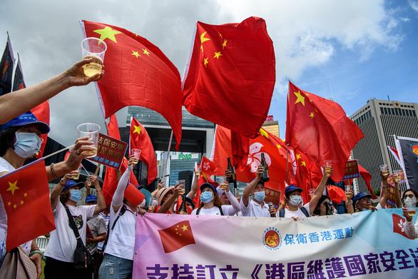 Báo Trung Quốc dọa Hong Kong: Thức thời cải tà quy chánh thì yên với luật mới - Ảnh 1.