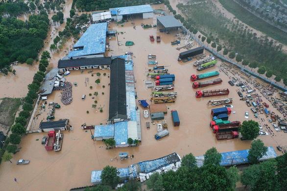 Tỉnh Giang Tây, Trung Quốc nâng cảnh báo mức cao nhất, lũ lớn sắp ập về - Ảnh 6.