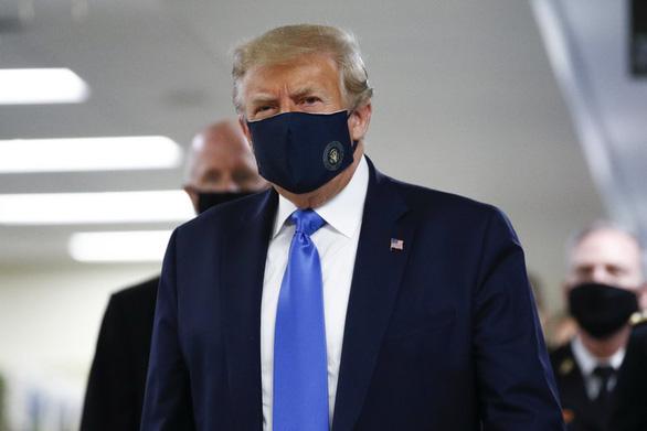 Dịch COVID-19 ngày 12-7: Ông Trump cuối cùng đã chịu đeo khẩu trang - Ảnh 5.