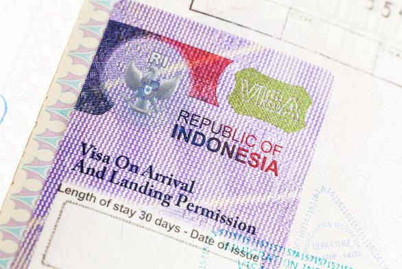 Indonesia buộc người nước ngoài kẹt lại vì COVID-19 phải rời đi trong 30 ngày - Ảnh 1.