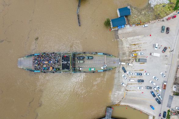 Trung Quốc điều 7.000 quân nhân, cảnh báo mưa lũ kéo tới miền bắc - Ảnh 1.