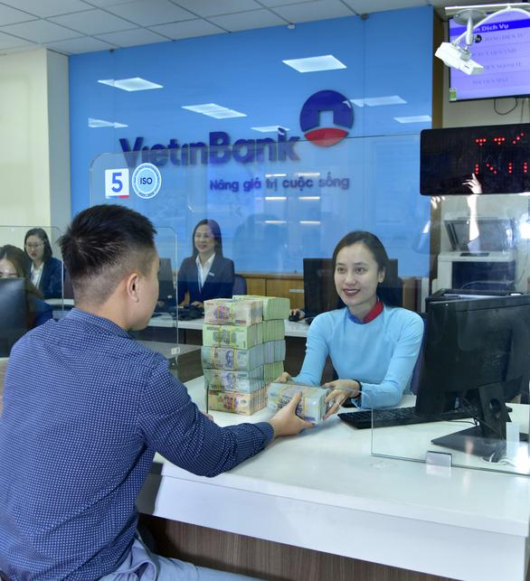 VietinBank luôn cung ứng đầy đủ vốn cho khách hàng - Ảnh 1.