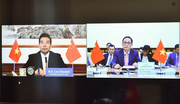 Việt Nam và Trung Quốc họp trực tuyến, bàn về tình hình quốc tế và Biển Đông - Ảnh 2.