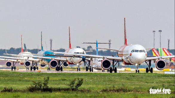 Hãng bay điều chỉnh kế hoạch khai thác ở Tân Sơn Nhất, Nội Bài - Ảnh 2.