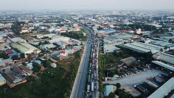 Bình Dương sẽ đặt trạm thu phí đường Mỹ Phước - Tân Vạn nối TP.HCM - Ảnh 1.