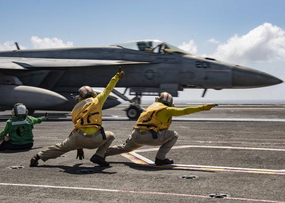 Mỹ điều tàu sân bay diễn tập chất lượng cao phòng bất ngờ ở Biển Đông từ 17-7 - Ảnh 1.