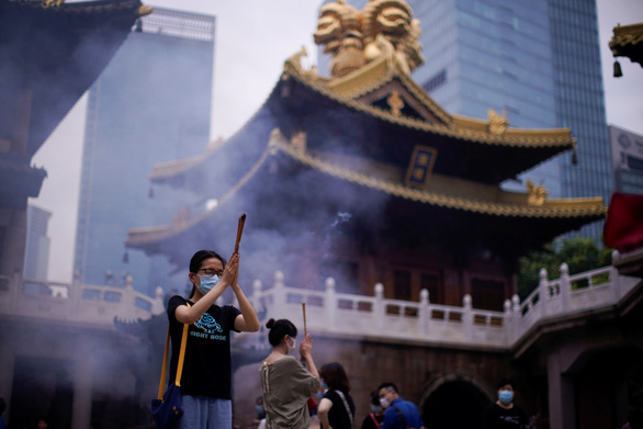 Thủ phủ của Tân Cương bước vào trạng thái thời chiến - Ảnh 1.
