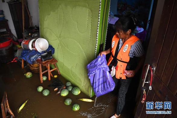 Lũ ụp nhanh, dân làng ở Trung Quốc gần như mất sạch - Ảnh 3.