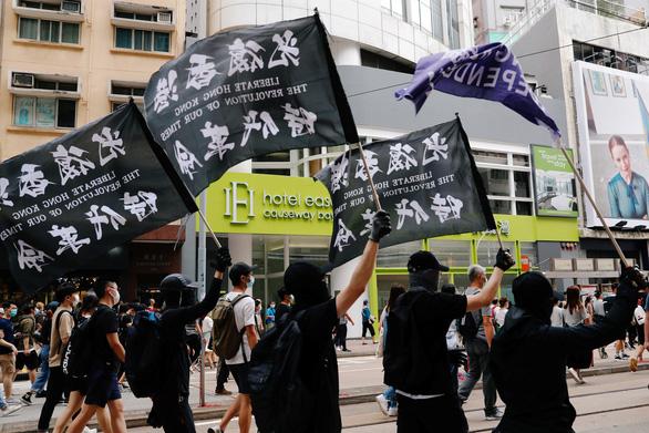 Lo ngại luật an ninh Hong Kong ảnh hưởng người dân khắp thế giới - Ảnh 1.