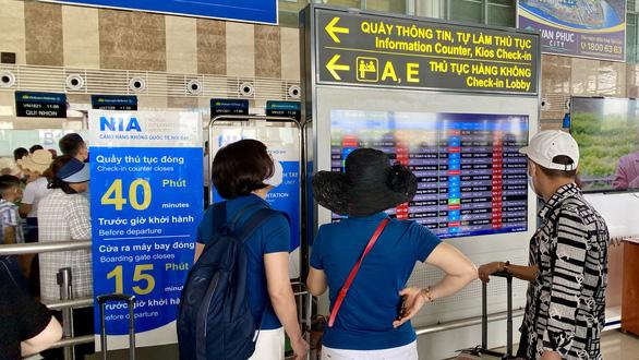 Sân bay Nội Bài hạn chế loa thông báo chuyến bay từ 30-7 - Ảnh 1.