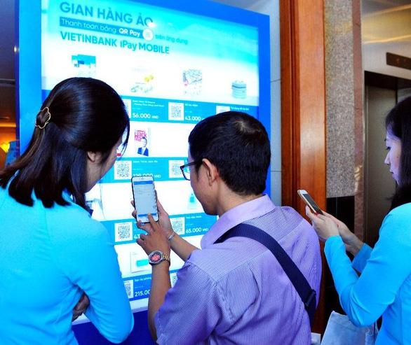 VietinBank đẩy mạnh phát triển thanh toán không dùng tiền mặt - Ảnh 1.