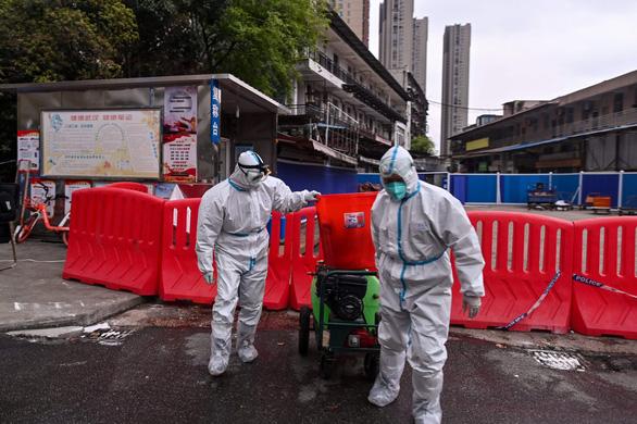Khi nào thì WHO điều tra xong dịch COVID-19 ở Trung Quốc? - Ảnh 2.