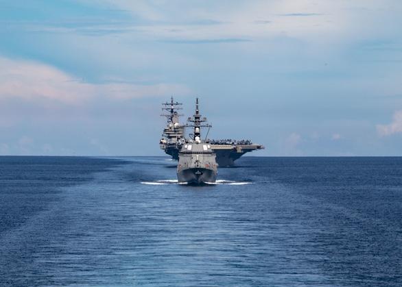 Nhóm Tứ giác kim cương tập trận trên biển, gởi thông điệp cứng tới Trung Quốc - Ảnh 3.