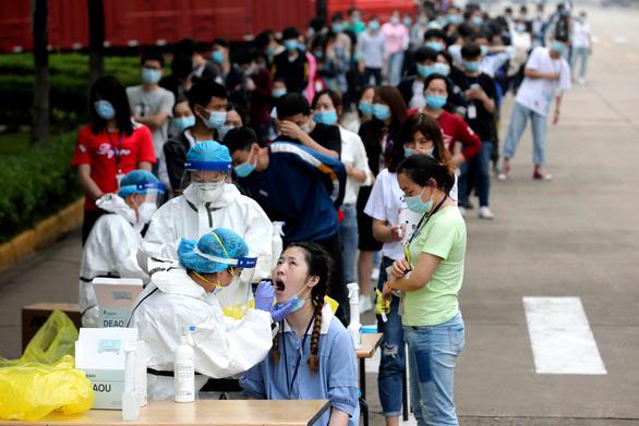 Khi nào thì WHO điều tra xong dịch COVID-19 ở Trung Quốc? - Ảnh 1.