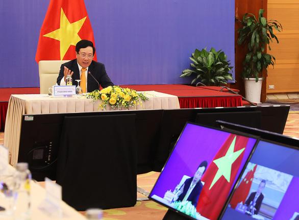 Việt - Trung đẩy mạnh hợp tác kinh tế, thẳng thắn về Biển Đông - Ảnh 1.