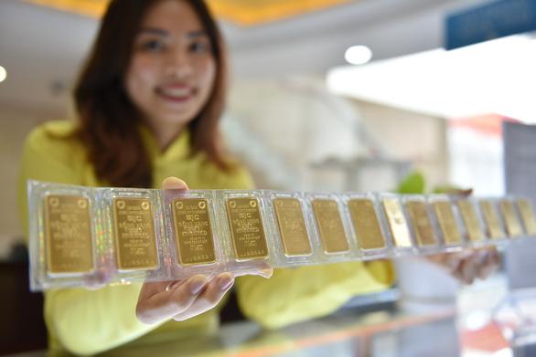 Xóa kỷ lục cũ, vàng miếng SJC lên 53,35 triệu đồng/lượng - Ảnh 1.