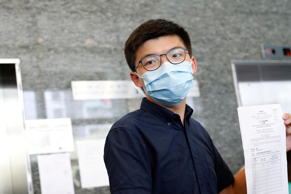 Joshua Wong nằm trong 12 ứng viên bị Hong Kong tước tranh cử vào cơ quan lập pháp - Ảnh 1.
