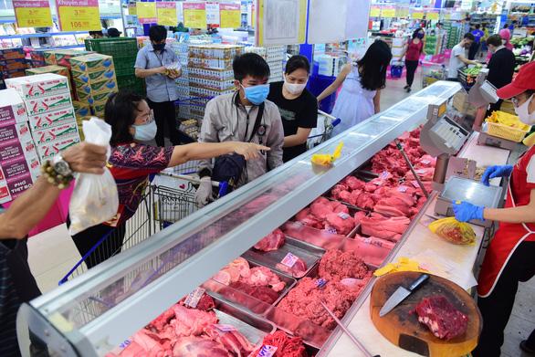 Saigon Co.op tăng dự trữ hàng hóa, chung tay chống dịch COVID-19 - Ảnh 1.