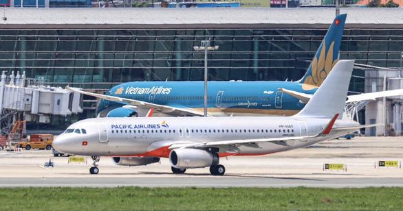 Từ ngày 29-7, mua vé Pacific Airlines sẽ dẫn về website của Vietnam Airlines - Ảnh 1.