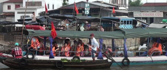 Cần Thơ dừng tổ chức ngày hội du lịch Văn hóa chợ nổi Cái Răng vì dịch COVID-19 - Ảnh 1.