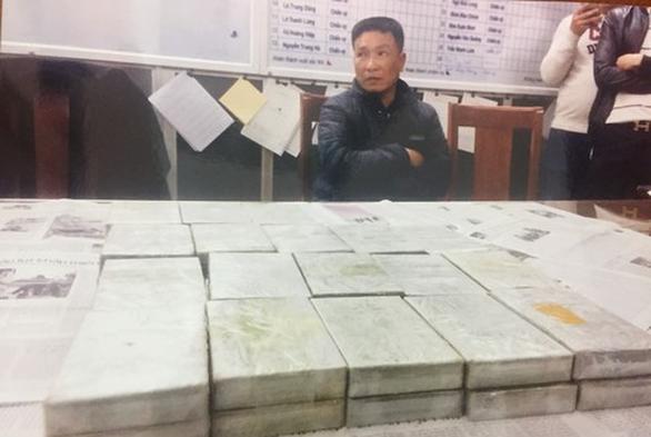 Đại gia đình mua bán 80 bánh heroin: 2 người tử hình, 3 người chung thân - Ảnh 1.