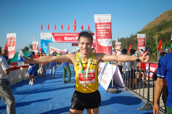 Hoàng Nguyên Thanh vô địch cự ly 42km tại Tiền Phong marathon 2020 - Ảnh 2.