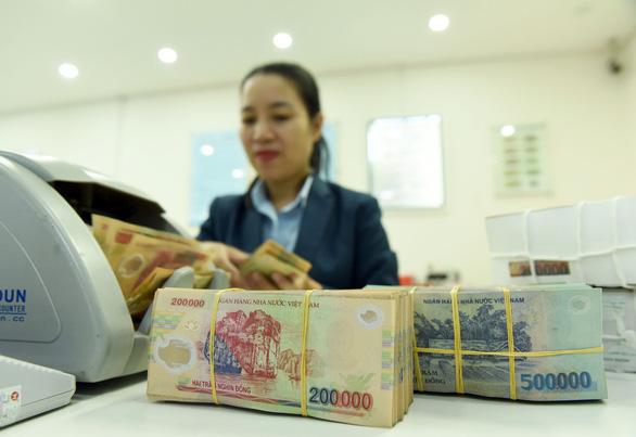 'Tăng trưởng kinh tế 2020 của VN dự báo thấp nhất trong vòng vài chục năm - Ảnh 1.