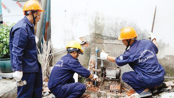 Hạn chế khai thác nước ngầm để giảm ngập - Ảnh 1.