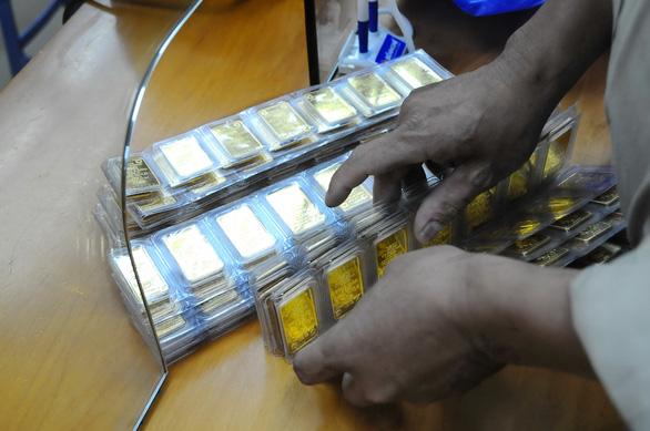 Giá vàng thế giới có vượt 2.000 USD/ounce trong tuần tới? - Ảnh 1.