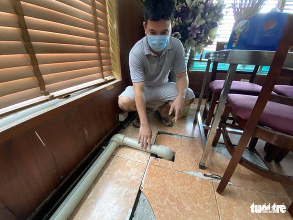 Dân chung cư ở Hà Nội kêu trời vì bể chất thải thấm sang nước sinh hoạt - Ảnh 3.