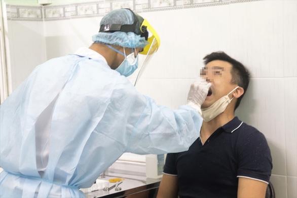 Người ở TP.HCM về từ Đà Nẵng cần theo dõi sức khỏe trong 28 ngày - Ảnh 1.