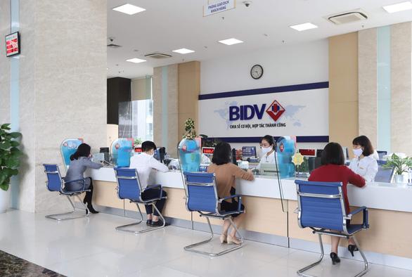 Ngân hàng đẩy mạnh thanh toán online mùa COVID-19 - Ảnh 1.