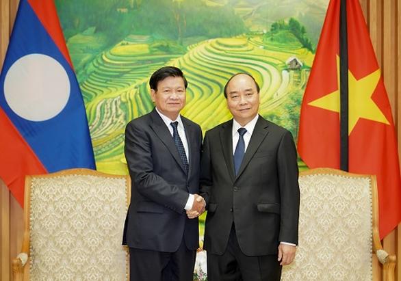 Thủ tướng Lào dự lễ tang nguyên Tổng bí thư Lê Khả Phiêu - Ảnh 1.