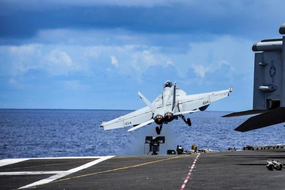 Tàu sân bay USS Ronald Reagan quay trở lại biển Đông - Ảnh 1.